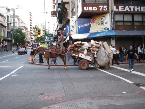 This is the Montevideo version of an environmentally friendly recycling program. These guys go around in their horse drawn cart and pick recyclables out of the garbage.