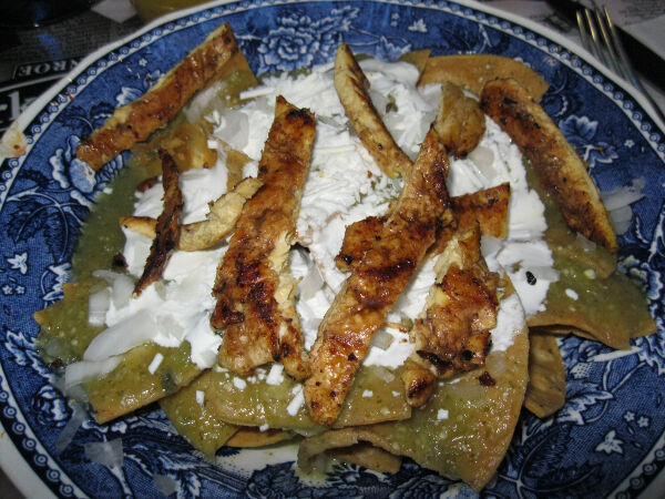 Chilaquiles with chicken.  Sort of like a really wet version of nachos.
