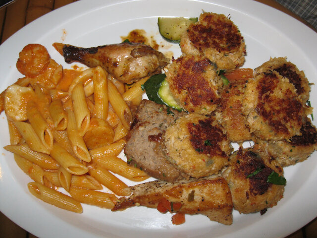 Crab cakes so good I ate at least eight of them. Plus scallops with penne pasta, meatloaf, chicken drumstick, and pan-seared tuna