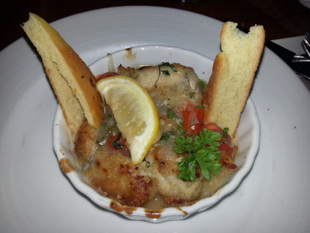 Frog legs with parmesan on top. Tastes like dark meat chicken