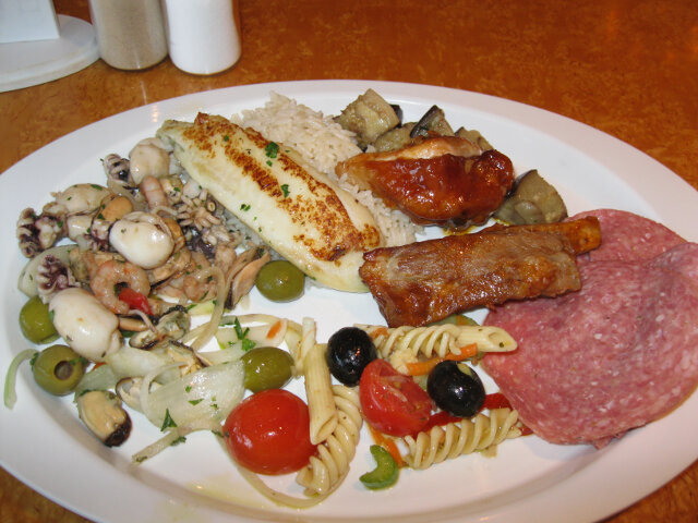 From the buffet - fish, ribs, eggplant, salami, pasta salad, seafood salad (clams, mussels,