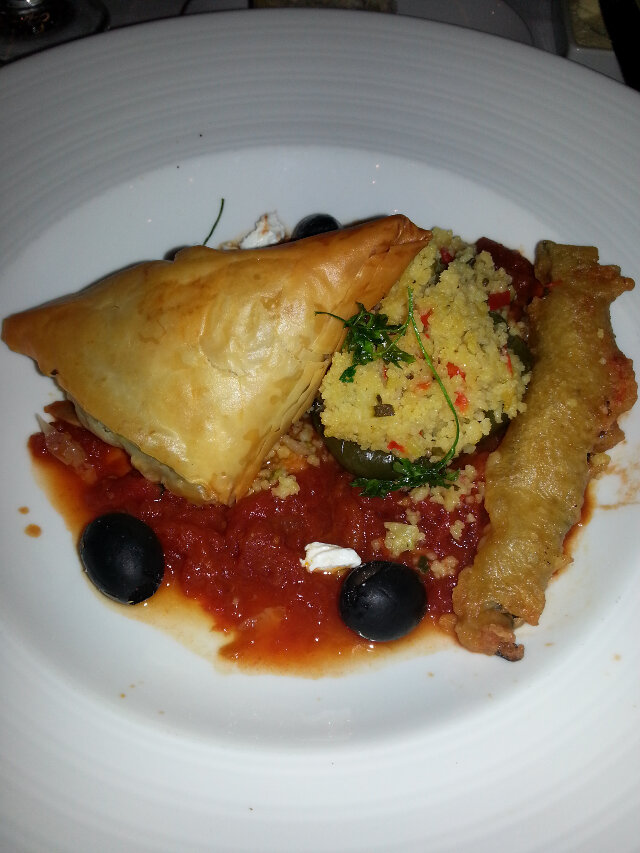 Spanakopita (greek pastry with spinach and feta inside), pepper stuffed with couscous. Another good vegetarian entree. Goes great with a side of steak (you can order a second main course any time you want).