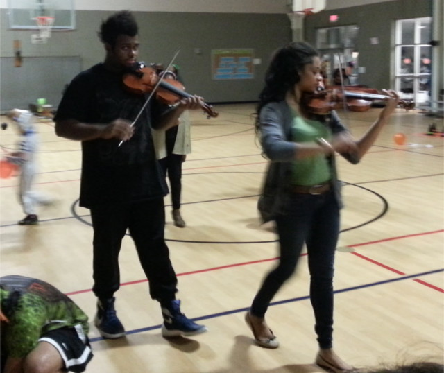 What's that? Oh, just a couple of Celtic fiddlers at our community Halloween festival that don't fit the typical mold.  Stereotypes are pretty worthless so many times.  This is what I like about our neighborhood.