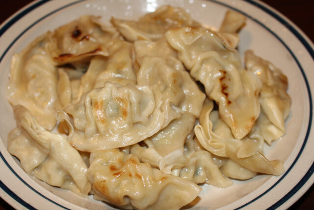 Not from a restaurant. $2.99 for a one pound bag of pork or chicken potsticker dumplings at Trader Joe's.
