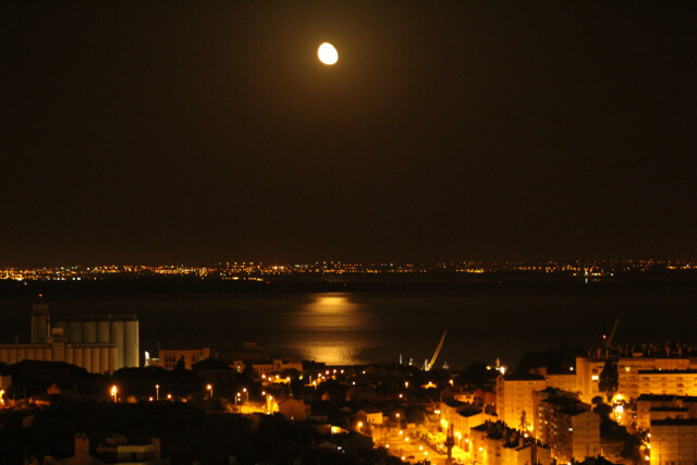 Moon reflecting on the Tagus River - view from our Airbnb.