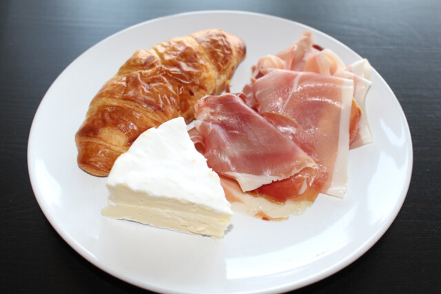 Homemade snack time sampler - croissant, camambert and prosciutto (called presunto in Portuguese)