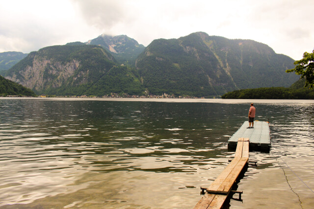 Free: Hanging out at the deserted marina on Lake Hallstatt in Austria. I'm catching a quiet moment on the lake while the kids are burning off energy on a tire swing in the park.