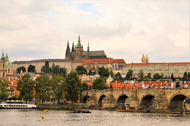 Prague Castle in the background and Charles Bridge in the foreground in Prague, Czech Republic. Transit in Prague is great - $3 to get the whole family across town to the castle by subway in 20 minutes.