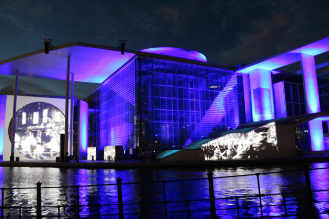 Each night Berlin projects a historical documentary/light show on the wall of this building. Sit on the steps along the river behind the Reichstag for the best view.