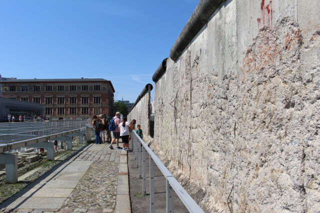 Section of the Berlin wall still standing in the center of downtown Berlin.